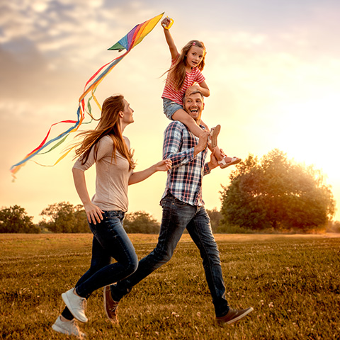 msp-developments-residential-slider-young-family-flying-kite-in-field_480x480