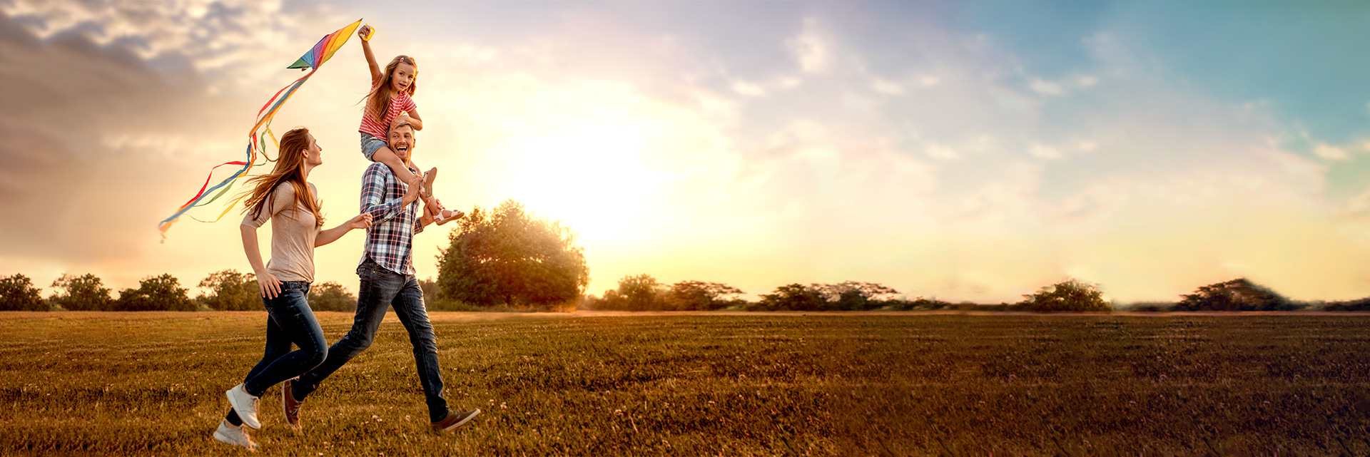 msp-developments-residential-slider-young-family-flying-kite-field_1920x641